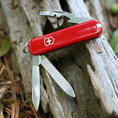 VICTORINOX<sup>&reg;</sup> Original Swiss Army™ Knife - Small pocket knife is packed full of tools.  Includes: blade, nail file and cleaner, bottle opener, screwdriver, wire stripper, key ring, tweezers and toothpick.  Made in Switzerland.