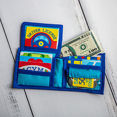 MELISSA & DOUG<sup>®</sup> Pretend-to-Spend Wallet - For both playtime and learning, this 45-piece fun wallet includes make-believe dollars and coins, store and membership cards and driver's license.  Not recommended for children under 3 years old.